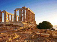 Greece. Cape Sounion - Ruins of an ancient Greek temple of Poseidon before sunset